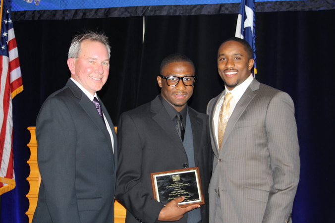 Jordan with Mike Hughes (left), Head Coach and Athletic Director at Plano West Senior High School </br>and Matt Owoseni (middle), recipient of the first <em>Pushing Upward. Going Higher.</em><sup>&reg;</sup> Award