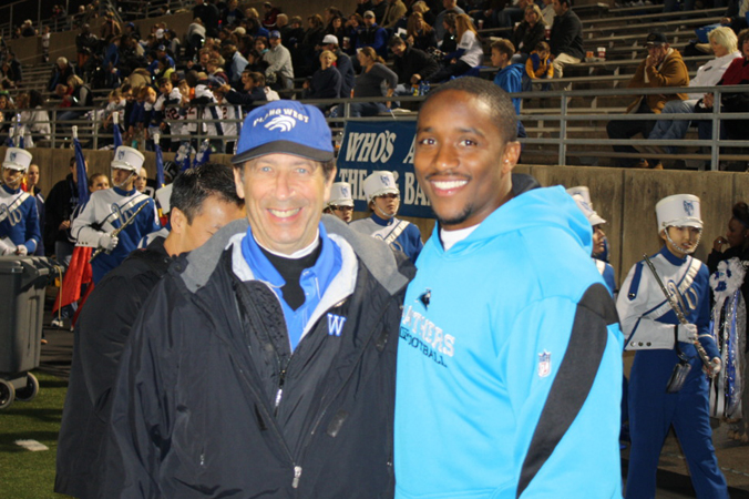 Jordan with Plano West Senior High School's team doctor.